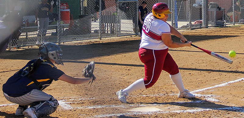 Jordan Harris / Courier Freshman Sara Quintero bats in two runners and lands herself a double in the first of two games against Barstow College at Jackie Robinson Park, Jan. 31, 2013. Lancers won 8-0.