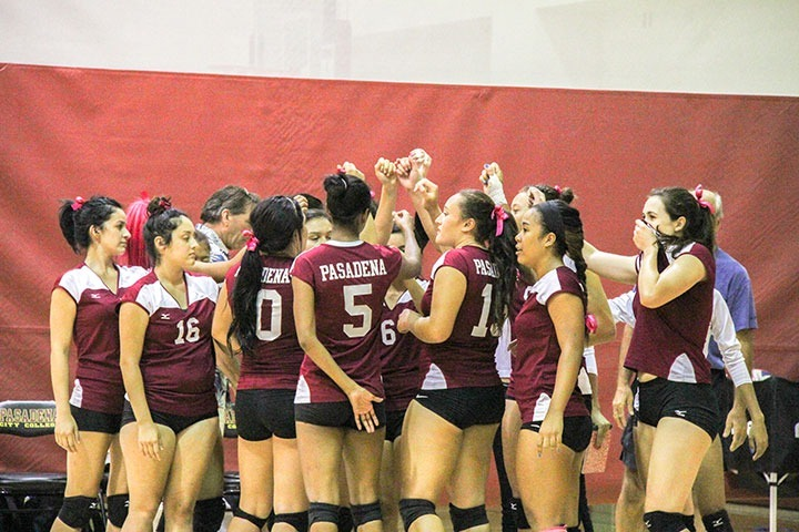 John Novak / Courier Womens volleyball celebrate their 3-2 win against Cypress on Wednesday, Sept. 18, 2013.