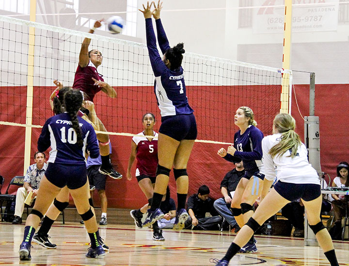 John Novak / Courier Thula Parks spikes the ball during Volleyball's game against Cypress on Wednesday, Sept. 18, 2013. They won 3-2.