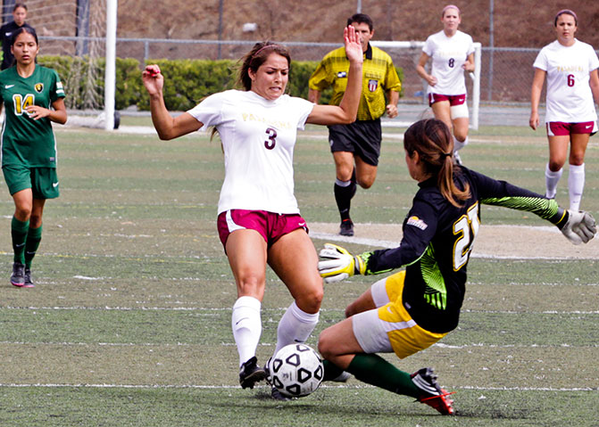 Cassandra Saavedra connects with the LA Valley goalkeeper Athena Del Rosario at LA Valley College on Sept 20, 2013.  With the defense holding strong the games ended in a scoreless draw.  (Courier/Benjamin Simpson)