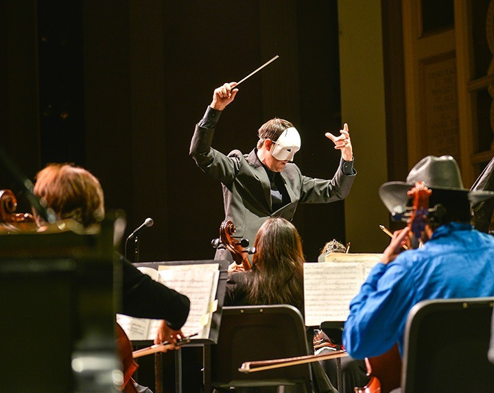 Teresa Mendoza / Courier Professor Michael Powers conducts the PCC orchestra during the Phantoms and Firebirds concerto in the Sexson Auditorium, Saturday, Oct. 26, 2013. The concert had