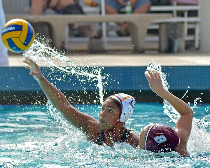 Teresa Mendoza / Courier PCC Lancer Scarlett Bonilla #13 throws the ball to score against Saddleback College during the Battle at the Beach Tournament held at Cypress College, Friday, Oct. 25, 2013. PCC lost 13-12.