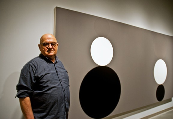 """Caitlin KellyThompson/Courier Bob Zoell stands by his favorite piece in his exhibition, """"Spots,"""" that debuted in the Boone Family Art Gallery at the Center for the Arts on Nov. 6."""