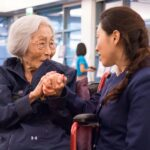 """100-year-old Susan Ahn Cuddy clutches the hand of actress Irene Park who portrays her in the East West Players production of """"Born to Lead: The Susan Ahn Cuddy Story"""" after a perfomance on Tuesday, March 24, 2015 in the Creveling Lounge at Pasadena City College in Pasadena, Calif. PCC veterans Maggie Sanchez and Jamaica Springs discussed their experiences in the armed forces following the short play. (Keely Damara/Courier)"""