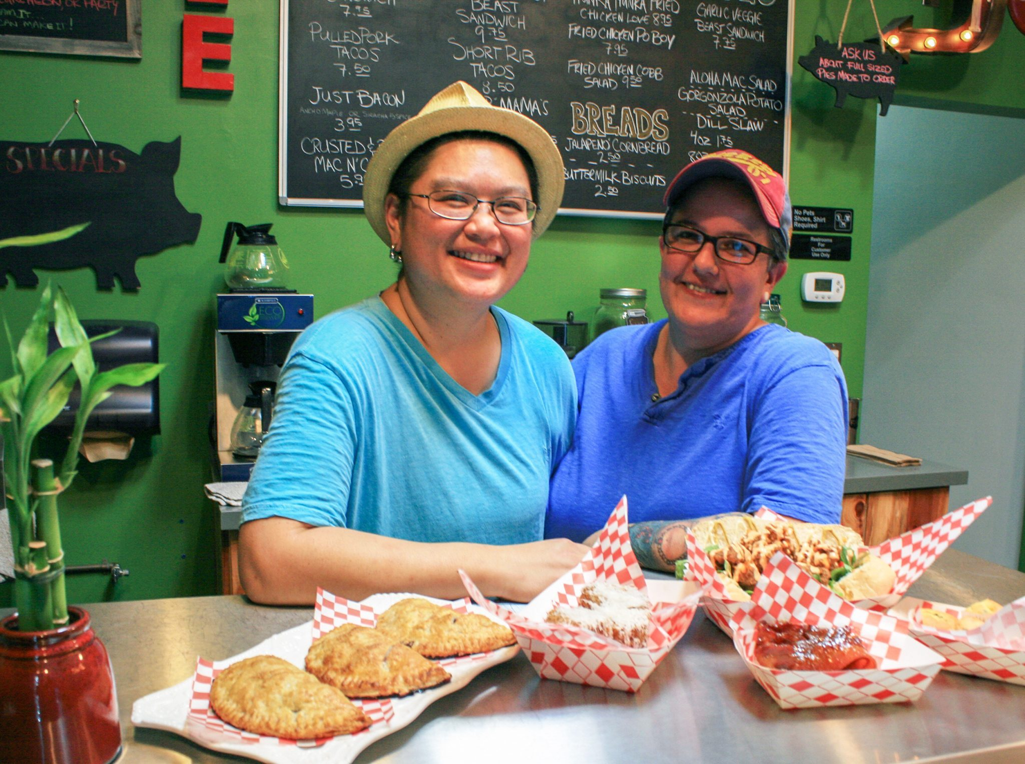 Monique LeBleu/Courier Chef and co-owners Ty Wu (left) and Shannon Hart (right) with their Chicken Po'Boy, Jalapeño cornbread, Crusted & Dusted Mac n' Cheese, Maple glazed bacon, and assorted pies at Braise & Crumble Cafe, Wednesday, September 2, 2015.