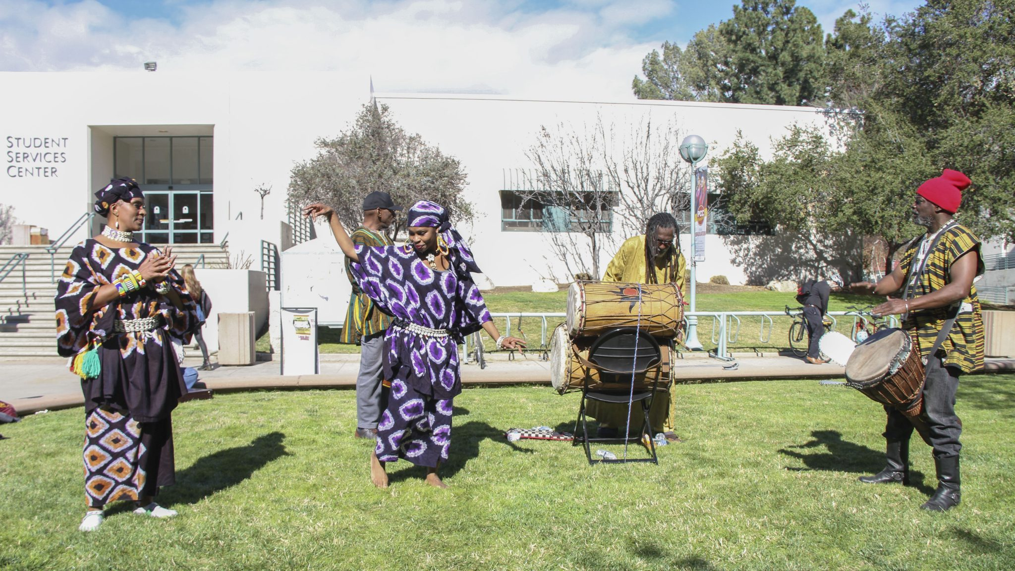 Eric Haynes/Courier - Kabasa dancer Teresa Smith speaks to the crowd after the performance with the Kabasa drummers in the quad on Tuesday, February 2, 2016. The Kabasa African Drummers & Dancers were a part of the opening ceremony for the month-long celebration of African-American heritage at PCC, hosted by Ujima.