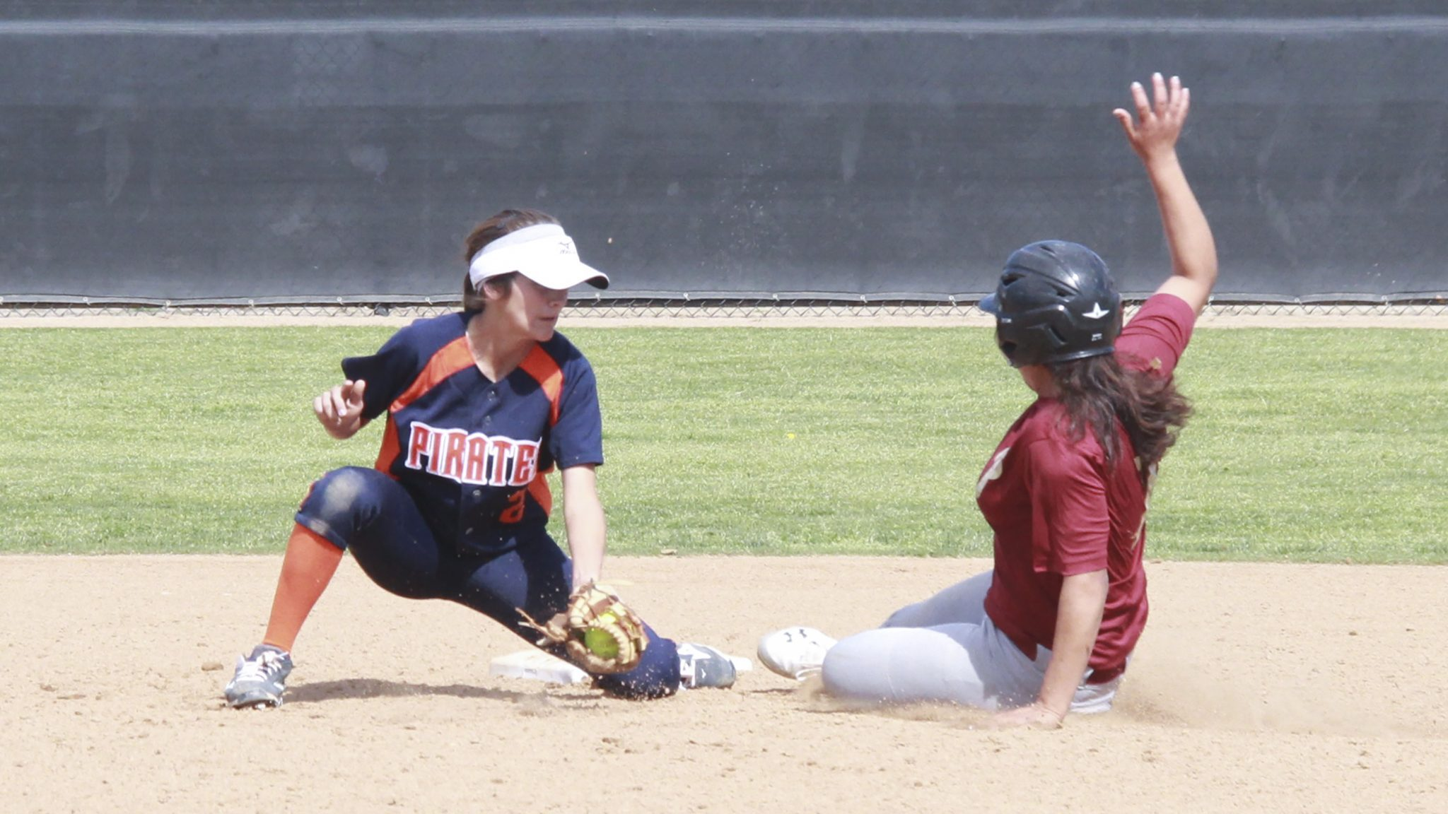 Irma Carrillo/Courier PCC's first baseman and out fielder Karen Nareja bumps fist with Assistant Coach Nolan Peralta as she got a single RBI down center field brining in Brenda Rivas at Saturday's game on February 20; 2016 at Orange Coast College.