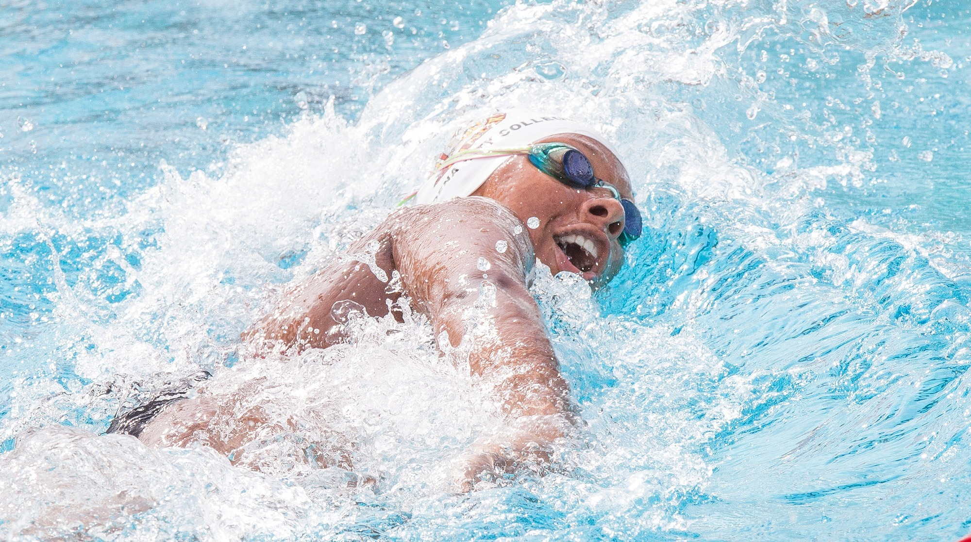 Katja Liebing/Courier Deborah McCandliss swims the 200-yard backstroke during a meet against East LA College and Long Beach College at Pasadena City College on Friday, March 4, 2016.