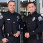 Eric Haynes/Courier PCC officers Michael DeSpain and Jose Arechiga are standing outside the campus police building on Wednesday, April 20, 2016. DeSpain and Arechiga won first place in the annual Baker to Vegas Run recently, representing PCC as the only college police department participating in the race since 2009.