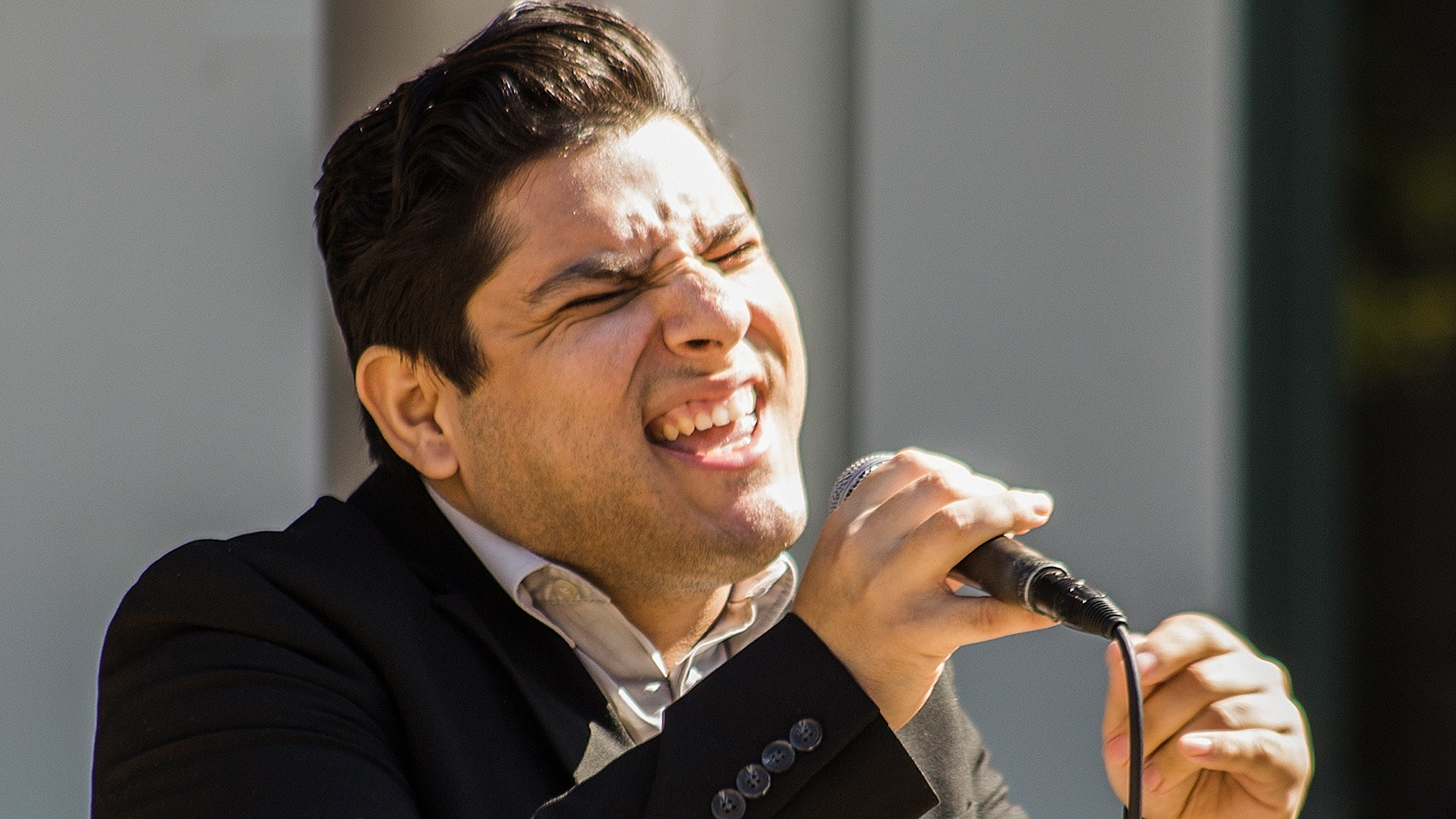 William Nestlehutt/Courier Bobby Novoa, one of PCC's Studio Jazz solo vocalists, performing by the Memorial Wall in the Center for the Arts West Patio on 10/25/2016